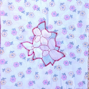 Isa's baby blanket, appliqué sewn by Sara